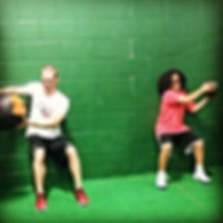 gym workout medicine ball workout training coach shawn green wall