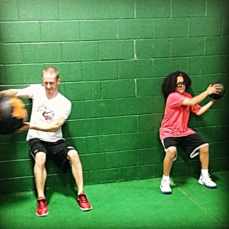 gym workout medicine ball workout training coach shawn green wall