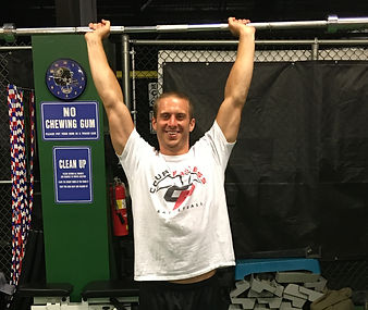 coach shawn lifting weights above head barbell