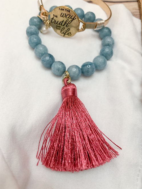 Powder blue semiprecious stone with rose tassel