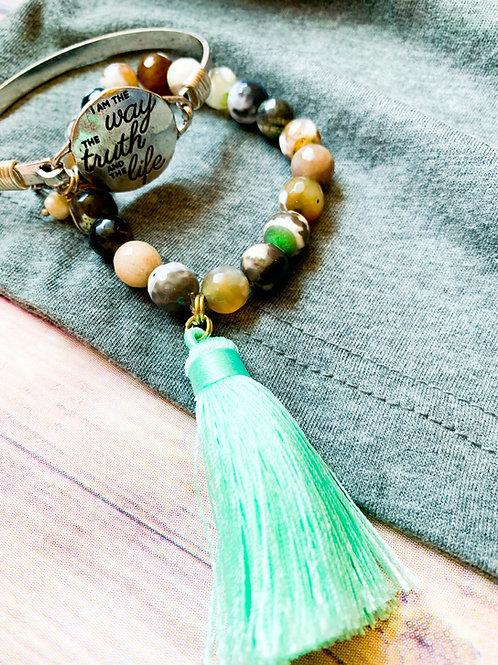 Multi color semi precious ston with a mint-teal tassel