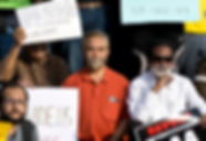 A group of men hold placards condemning the Citizenship Amendment Act (CAA).