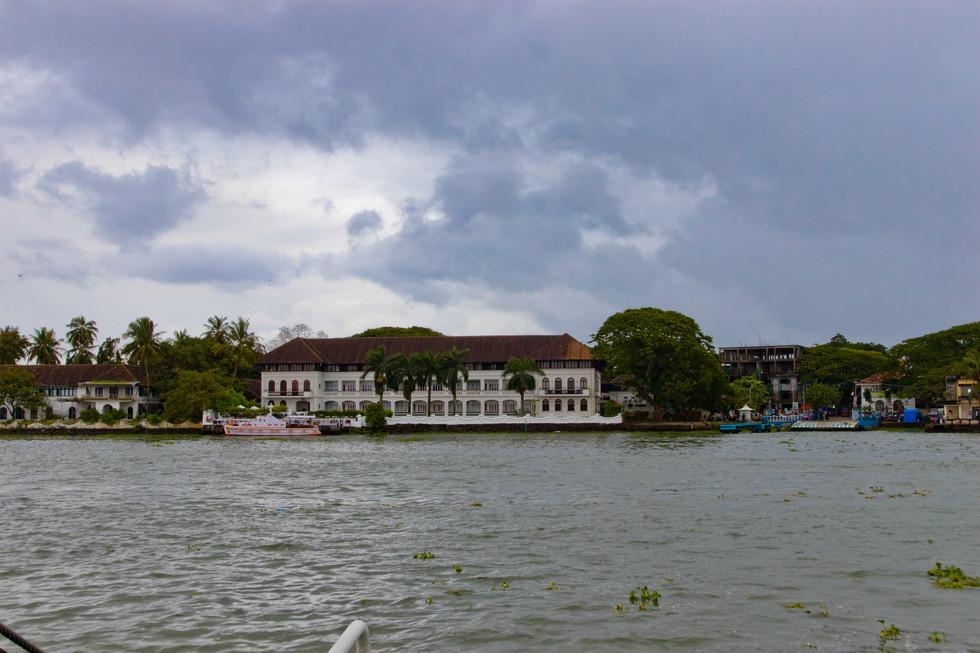 Colonial building overlooking bay