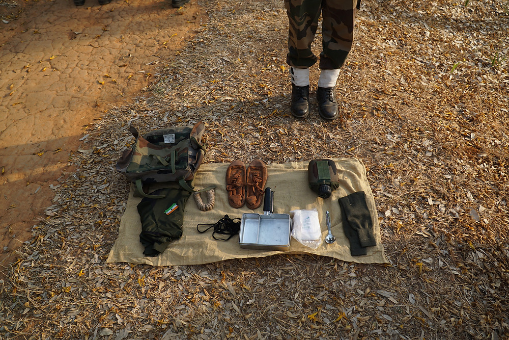 A private shows the contents of her haversack for a three-day march. However, while she is supposed to have 16 items in the bag, she clearly had less than that number in the bag - for which she was reprimanded by her commander.
