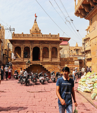 Boy walks in front of temple