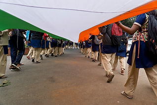 College girls carry an 80-metre long Indian flag along a busy road in Bangalore.