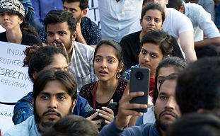 A young women listens in awe to social activist, Harsh Mander, speak at the rally.