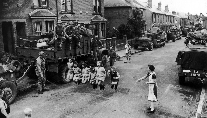 US troops help entertain British children in Britain before D-Day.