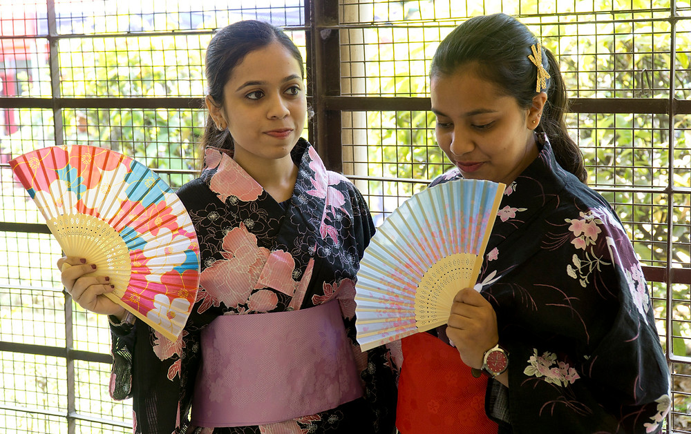 Shubhangi, 22 (on left), an IT professional, wears a Kimono.