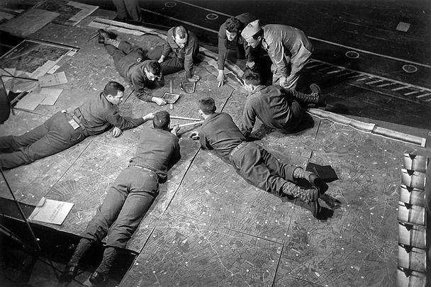 Men look at the Omaha beach assault area