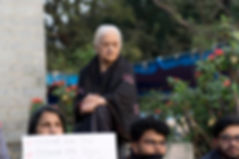 Ila, 86, attends a rally condemning violence against students.