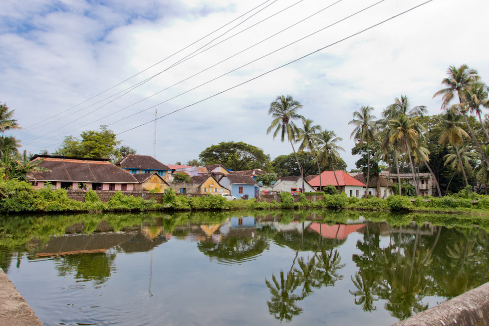 Indian homes along a pond