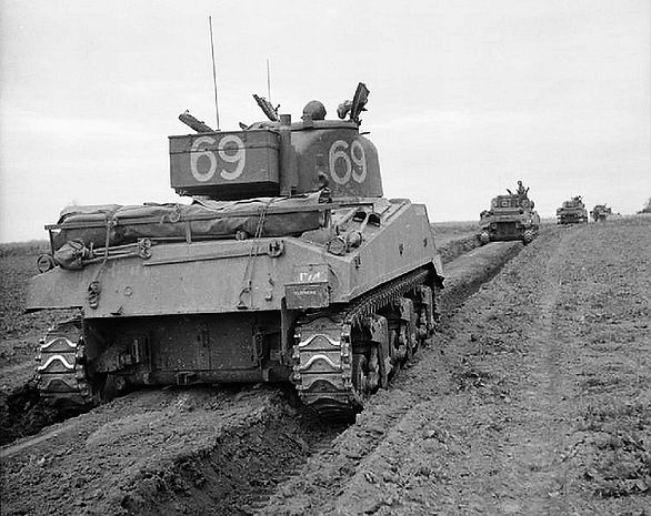 Shermans of the 27th Brigade advance