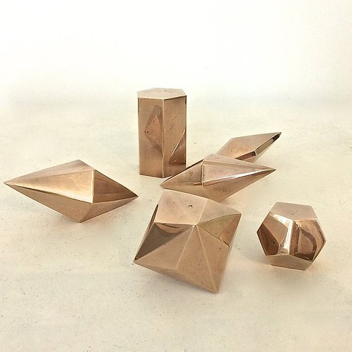 Set of six polished bronze geometrical forms, circa 1960, France.