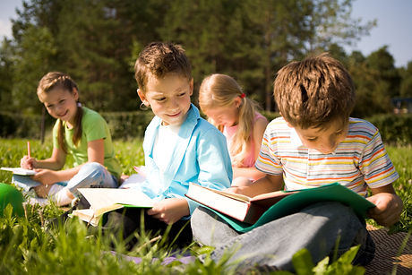 Portrait of cute kids reading books in n