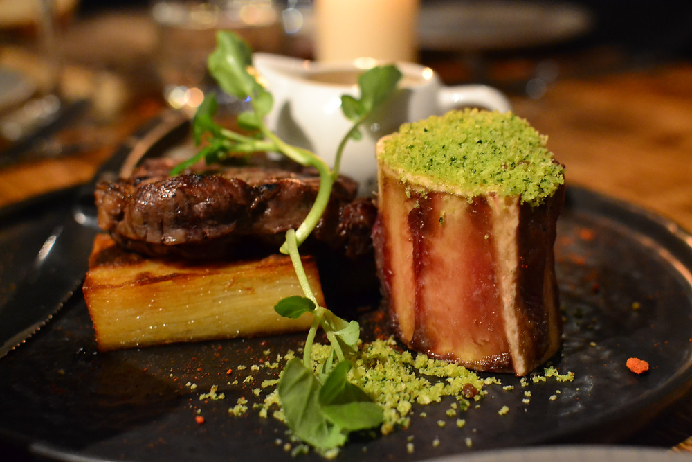 Steak, potato dauphinoise and crusted bone marrow