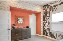 Wheatridge Roses with orange wall