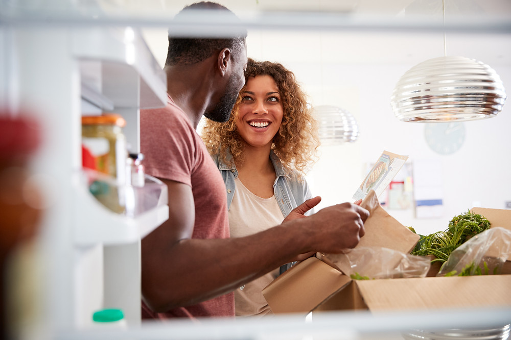 Boss of My Money Food Budget -couple unpacking grocery