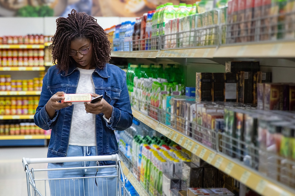 Boss of My Money Food Budget - lady looking at product in super market