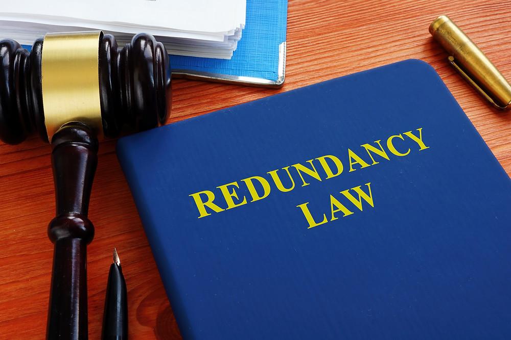 redundancy law book on desk