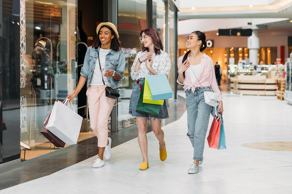 Three friends shopping in the mall