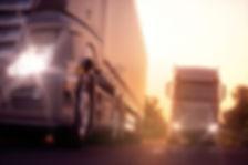 trucks-driving-sunset-1024x683.jpeg