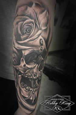 Skull and rose head