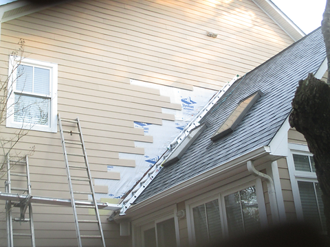Siding-Repair-and-Paint-in-process.png