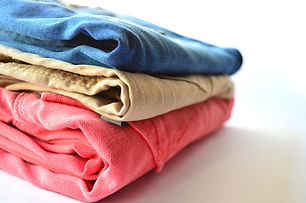 Folded laundry stacked folded and hung laundry services at Maid OK