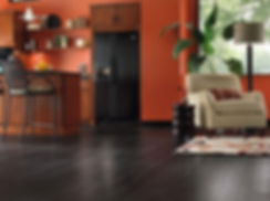 Laminate flooring that looks like dark blac hardwood. Kibuk Construction