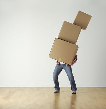 Man carrying cardboard boxes stacked above each other in Castle Rock, CO.