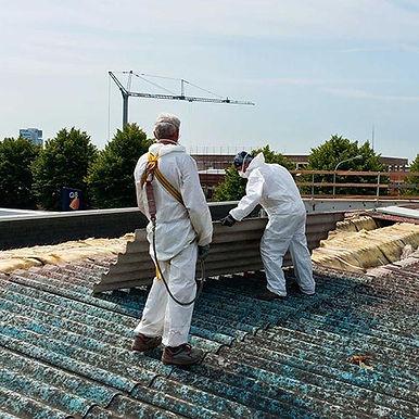 Inspectors conducting asbestos testing on roof