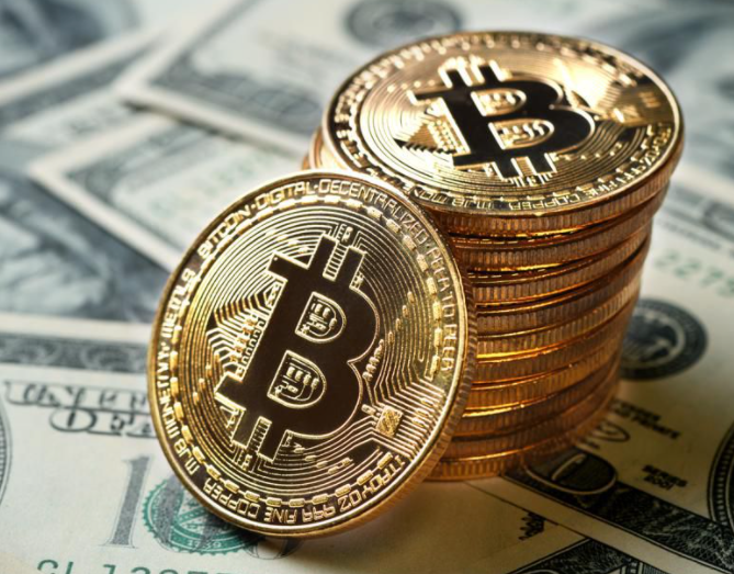 """Image of bitcoin """"currency"""", coins stacked with Bitcoin symbol"""