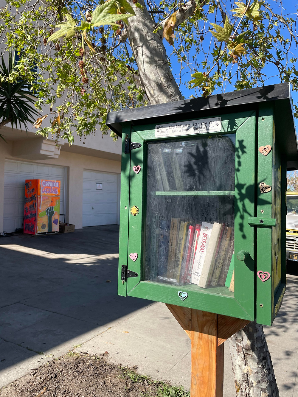 Free little library at the Mid City Community Fridge