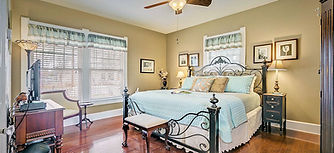 Granbury Suite with king bed and windows overlooking the back yard.and  Suite-King.jpg