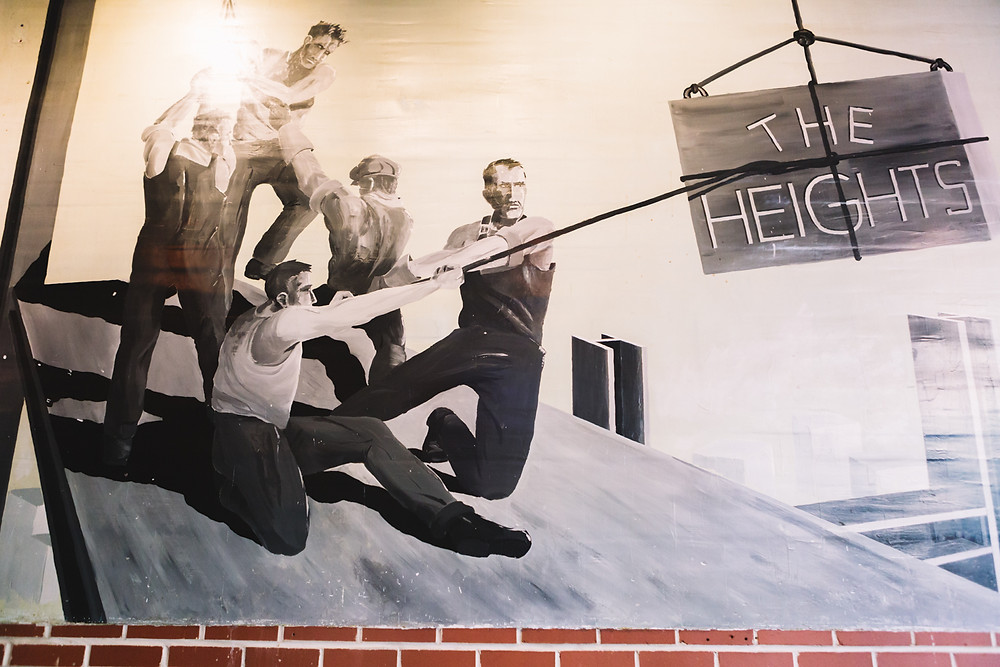A photo hang at the entrance to The Heights Bar & Grill