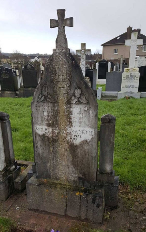 Headstone badly affected by the weather and eliments.