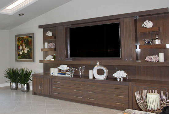 "14""Walnut Entertainment Center. Lots of storage. Built in speakers. Custom led lighting."