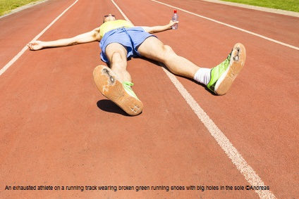 An exhausted athlete on a running track