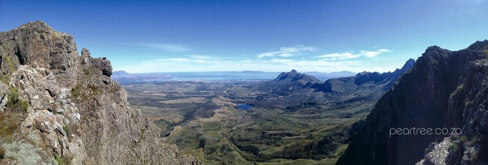 View from Swartboskloof Jonkershoek top towards Helderberg Basin Lourensford and False Bay