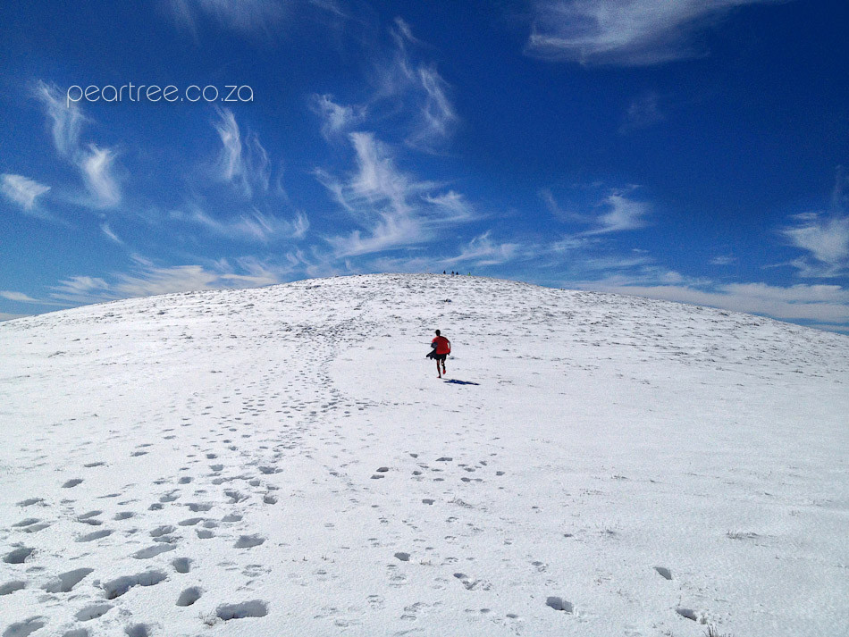 Snow covered Victoria Peak with Trail Runner