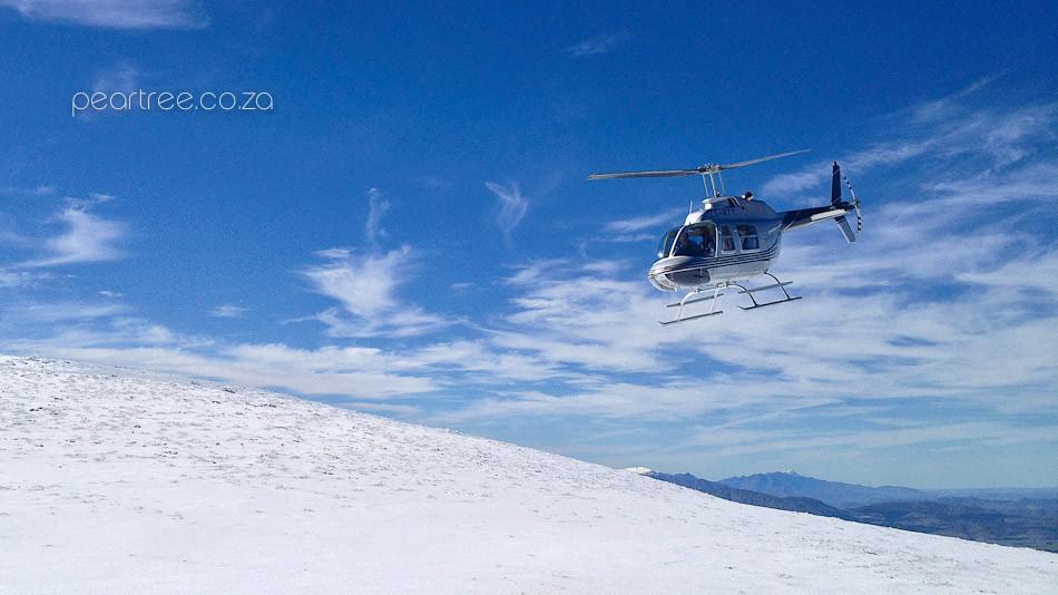 Helicopter on top snow cover Victoria Peak Jonkershoek