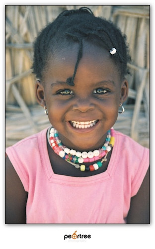 Another Theme Photograph:  This beautiful girl was found as a through away baby in a Nairobi slums.  The missionaries I met adopted her and gave her hope and a new life.