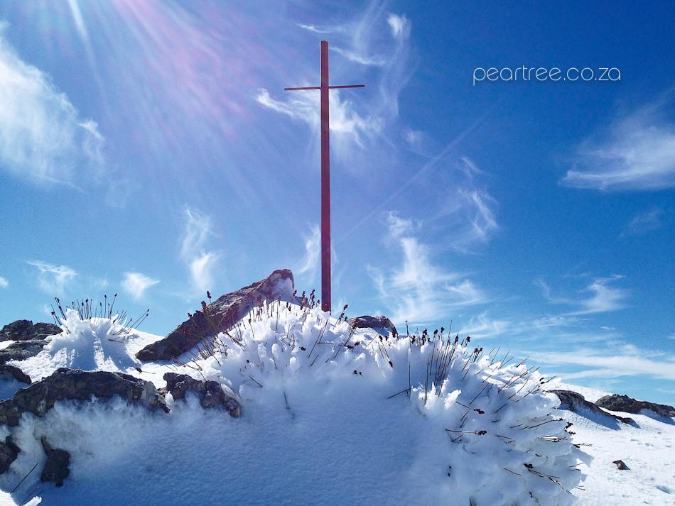Cross on snow covered Victoria Peak Jonkershoek