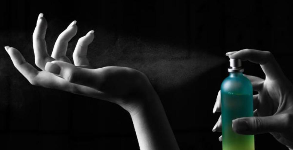 perfume-being-sprayed-onto-a-wrist_edite