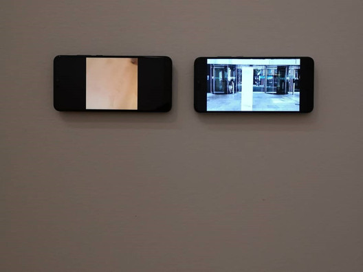 The Artist & The Undertaker.  2019, Auckland Art Gallery  Video, 2 x Mobile Phones  The Artist & The Undertaker is a 3 minute loop inspired by David Mealing's public withdraw of his work at the Auckland Art gallery, Groundswell: Avant-Garde Auckland 1971–79.    Video Link below ( Intended listening with headphones)