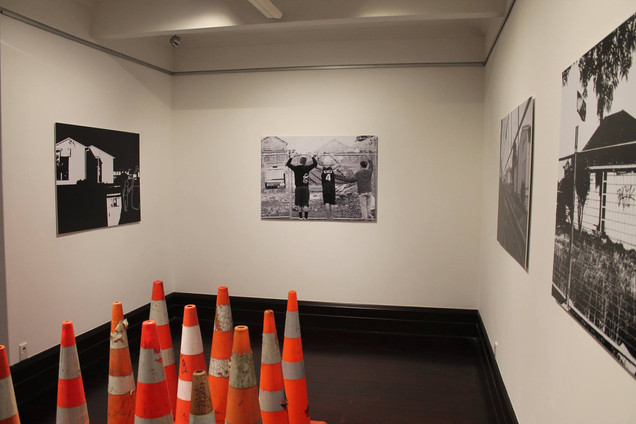 Bystander of Tomorrow, 2016  Nathan Homestead, Manurewa, Auckland  A2 Digital Prints  Installation  Chantel Matthews (Perawiti) grew up in Glen Innes. There is currently a major overhaul of state housing and re-development taking place in this area. Streets have been demolished making way for a new modern multi-cultural community.  Exploring this 'modern multi-cultural community' Matthews-Perawiti likens it to the Maori Land March in 1975 where alienation, land, power and cultural shifts were central catalysts for protests. In this free for all land grab the gap between those that have and those that have not widens leaving this small suburb of locals watching as 'politics' moves in.  'Bystander of Tomorrow' talks about protest, the cultural shifts and the future generation where land or the idea of 'home' looks out of reach.  https://www.stuff.co.nz/auckland/87647744/chantel-matthewsperawiti-documents-changing-landscape-of-glen-innes