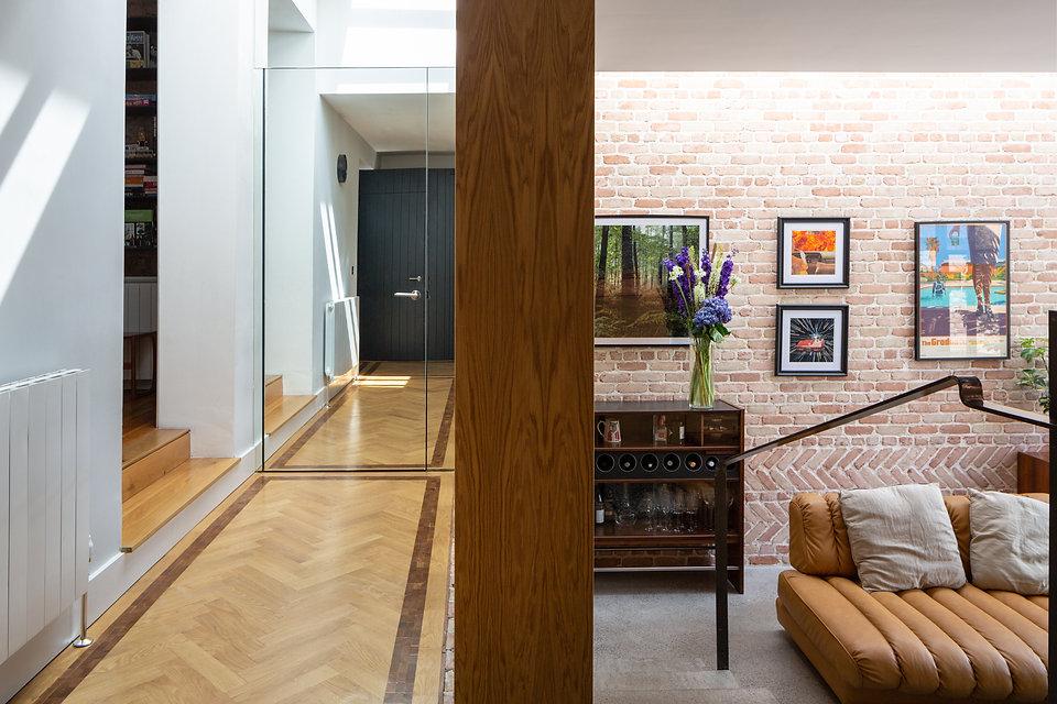 Mirrored wall oak brick concrete