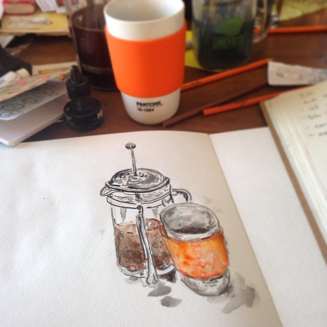 painting watercolor and drinking coffee
