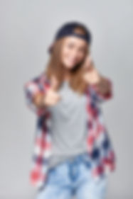 Smiling happy teen girl pointing at came